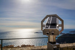 Coin operated binoculars. With seascape in the background Stock Images