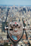 Coin operated binoculars on Top of the Rock, against Empire State Building – Manhattan, NYC Royalty Free Stock Photos