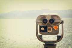 Coin operated binoculars viewer in front of the sea landscape Royalty Free Stock Images