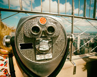 Coin operated binoculars with vintage effect on Empire State Bui Royalty Free Stock Images
