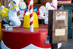 Coin operated childrens ride. Peshastin, WA, USA October 22, 2016: Classic coin operated merry-go-round for children Royalty Free Stock Photo