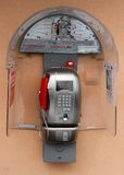 Coin-operated phone with phone booth Stock Photography