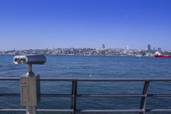 Coin operated public binocular by the sea overlooking bosphorus royalty free stock photography