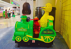 Coin operated Sesame Street themed kids rides in shopping mall. The two popular characters on The Big Bird Express are Elmo and Big Bird itself waiting for Royalty Free Stock Image