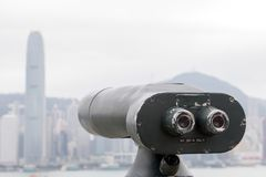 Coin-operated telescope directed on Hong Kong. Coin-operated telescope directed on skyline of Hong Kong Royalty Free Stock Image