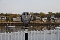 Coin operated telescope looking over waterway Royalty Free Stock Photo
