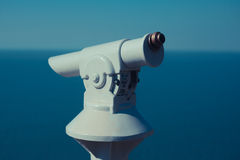 Coin operated telescope by the sea Stock Photos