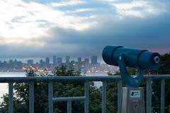 Coin operated viewfinder pointing Seattle skyline stock image