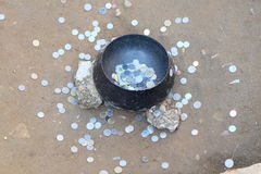 Coin. The people put coin offering in a Buddhist monk's alms bowl Stock Image