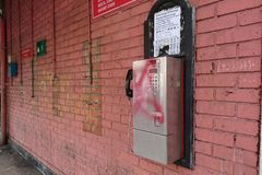 Public phone coin stock image