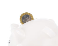 Coin and piggy bank. One euro coin and piggy bank isolated on white Stock Photos