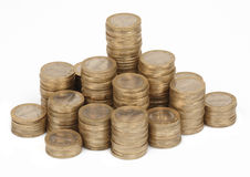 Coin pile. Large pile of coins isolated on white Royalty Free Stock Images
