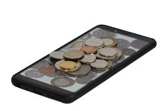 Coin pile on the smartphone. stock images