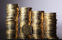 Coin piles Stock Images