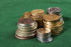 Coin piles. Stacks of various coin on the green Stock Photography
