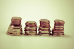 Coin piles retro style photo shot. Stock Photography