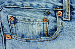Coin pocket of a blue stylish jeans Stock Image