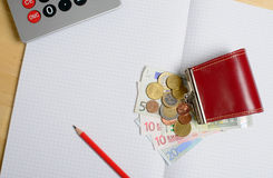 Coin purse with money and notebook Royalty Free Stock Photography