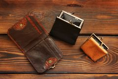 Coin purse on a wooden background royalty free stock photo