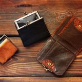 Coin purse on a wooden background royalty free stock images