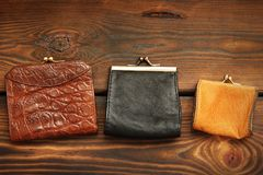 Coin purse on a wooden background royalty free stock image