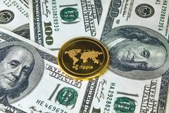 Coin ripple gold xrp close up, the coin on American dollars money stock photos