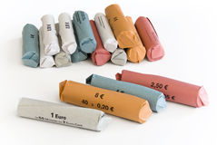 Coin Rolls Euro Money. Euro coins rolled lying on white Background royalty free stock photo