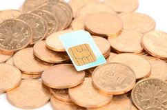 Coin and sim card Stock Photography
