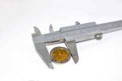 Coin sized by vernier tool Stock Images