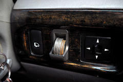 Coin slot in car. Use for collect your change Royalty Free Stock Image