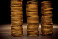 Coin stack on black bacground stock photography