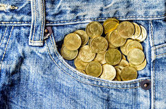 Coin stack and blue jeans lack stock image