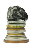 Coin stack with coal on top Royalty Free Stock Photos