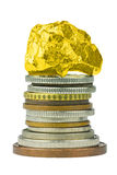 Coin stack with gold nugget on top Stock Photography