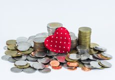 The coin stack and red heart isolated on white Stock Photos