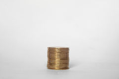 Coin stack on white background money value buisness finance. Hand put coin on a stack of coins Royalty Free Stock Image