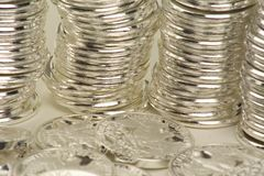 Coin stacked. Silver coins stacked in rows stock images