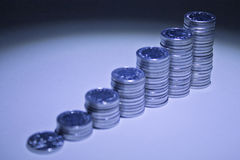 Coin stacks ascending in height. Royalty Free Stock Images