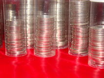 Coin stacks in clear tubes Royalty Free Stock Photos