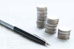 Coin stacks, pen and savings account passbook or financial statement on office desk table. Business, finance, saving money or investment concept : Coin stacks Stock Photos
