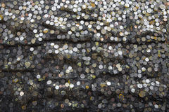 Coin on stone. Coins on the stone walls that were sealed by the droppings Royalty Free Stock Photo