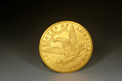 A coin ten dollar gold Stock Photography