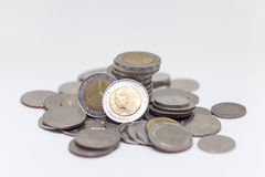 Coin, Thai currency in background and isolated Royalty Free Stock Images