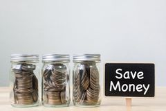 Coin in three jar with black board, Concept save money or invest. Ment financial, Copy space Stock Photo