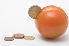 Coin in tomato Royalty Free Stock Photos