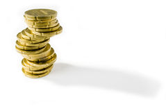 Coin tower. A shot of stack of coins isolated on white Royalty Free Stock Image