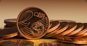 Coin of two euro cents in the background of coins. Panoramic and web banner Royalty Free Stock Photos