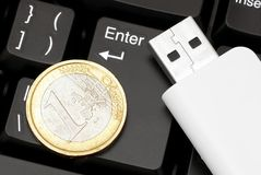 Coin and usb flash card. Stock Photos