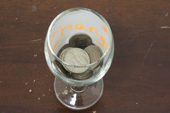 Coin in wine glass. Change for Life Stock Images