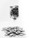 Coin in wine glasses. Black and white colour Royalty Free Stock Image